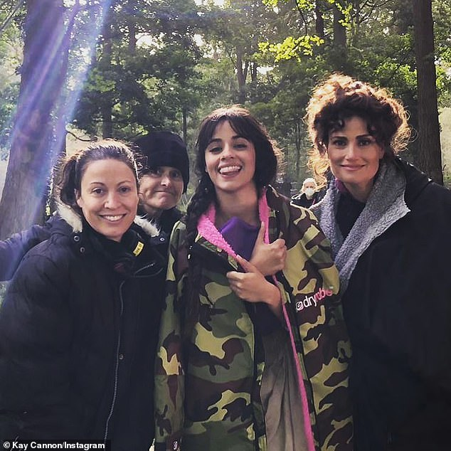 Action! Three-time Grammy nominee Camila Cabello (M) continued filming Kay Cannon's (L) modern live-action remake of Cinderella in England on Sunday alongside her onscreen stepmother Vivian played by Tony winner Idina Menzel (R)