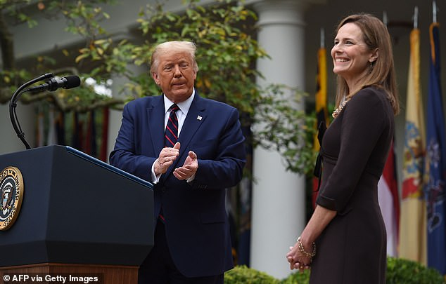 Trump nominated Barrett (right) to the vacant Supreme Court seat on Saturday, and was forced one day later to defend his pick and her religion