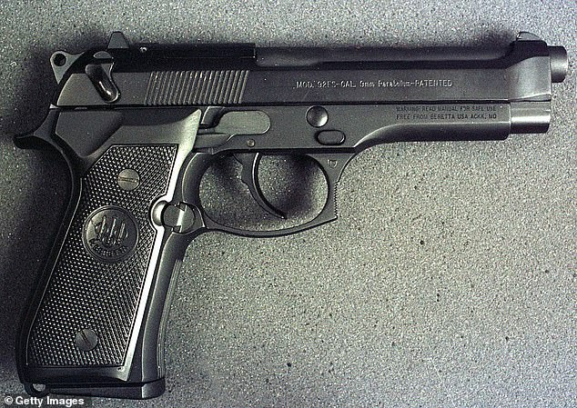 According to investigators, Alexander shot Smith with the coach's own 9MM Beretta gun (like the one seen in the above file photo)