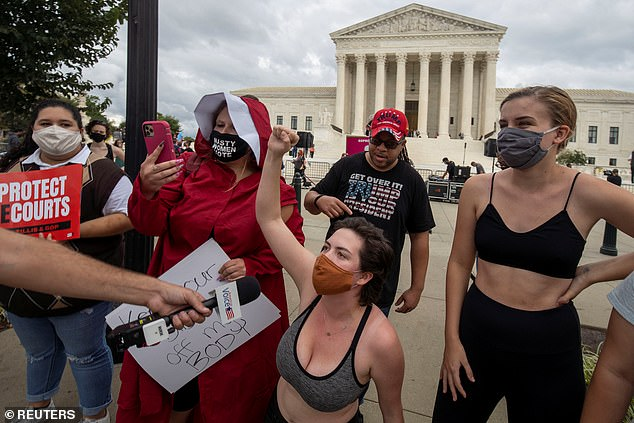 Protestors demonstrate outside the U.S. Supreme Court on Sunday