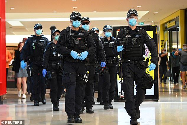 A disproportionate number of fines for breaching COVID-19 restrictions are being dished out to the vulnerable members of the community, new data shows. (pictured: police in Victoria patrol a shopping centre)