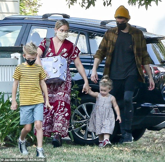 Family affair: The 32-year-old Disney Channel alum was joined by husband Matthew Koma, 33, their daughter Banks Violet, one, and her son Luca Cruz, eight