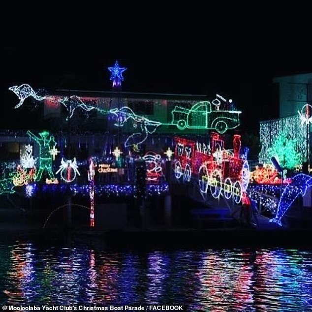 The event sees 30,000 people line the river bank to watch boats with incredible displays - such as Santa's reindeer - and people dressed up as Santa sail by them