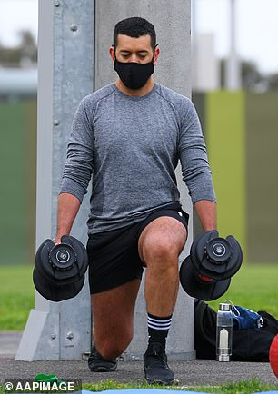A personal trainer wears a mask in Richmond