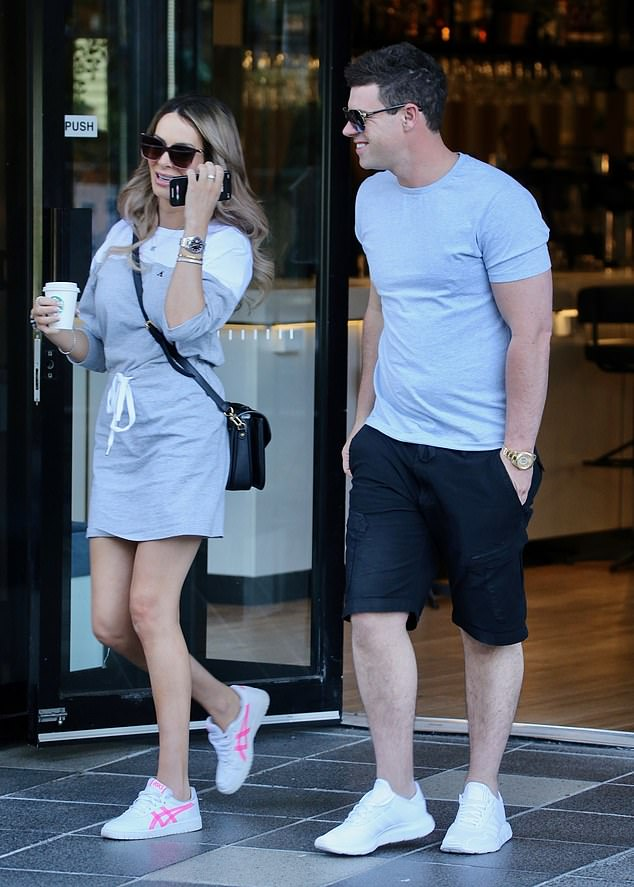 Looking good: Stacey showed off her trim legs in a thigh-skimming grey and white sweater dress which she teamed with a chic black shoulder bag
