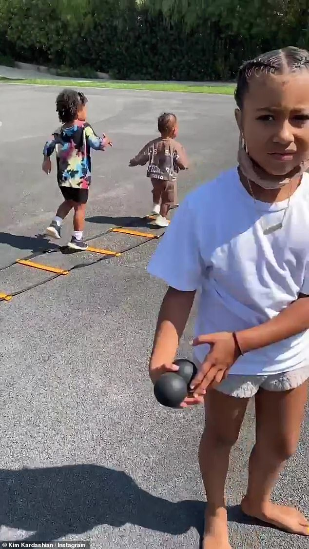 Crashed: Kim Kardashian had her workout session crashed by daughter North, seven, sons Saint, four, and Psalm, one, and her niece True, two, on Sunday afternoon