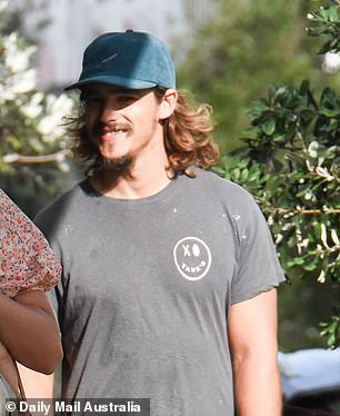 New look: The Aussie actor looked world's away from his days in Summer Bay as he sported facial hair and long locks
