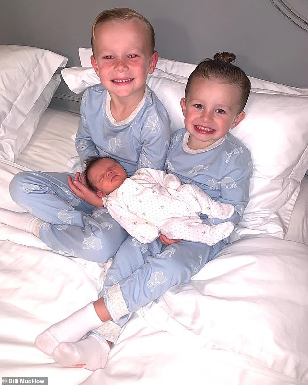 Family matters: Billi Mucklow shared an adorable snap of her two sons, Arlo, four, and Wolf, two, cradling her newborn daughter, Marvel Mae, on Sunday evening