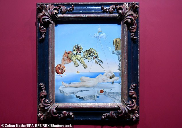 Dream Caused by the Flight of a Bee Around a Pomegranate a Second Before Awakening by Salvidor Dali, who often drew on themes of dreaming