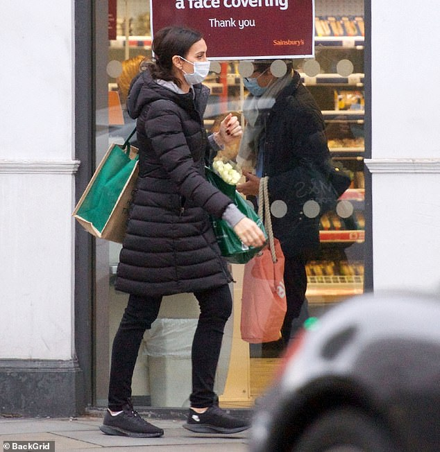 Relaxed:Following the drastic change in temperatures, Christine opted for a cosy black padded coat teamed with a grey hoodie and trainers