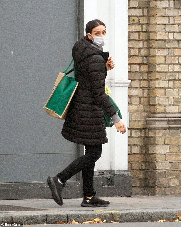 Casual: The Loose Women star donned a face mask as she headed out of Marks and Spencer laden with bags