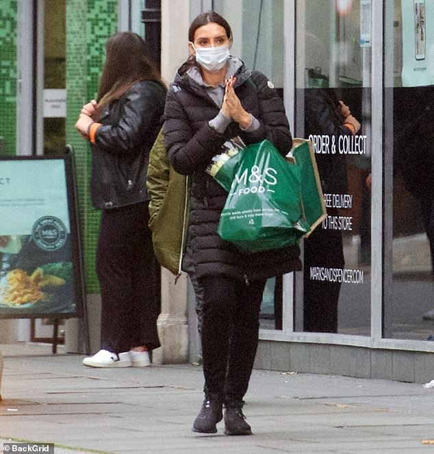 Low-key:Christine Lampard, 41, cut a laid-back look in a cosy black padded coat as she headed to the supermarket on Sunday