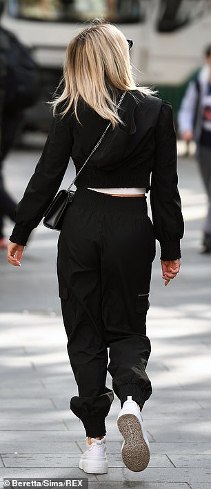 Black and white look:While she completed her laid back ensemble with a chunky pair of white trainers