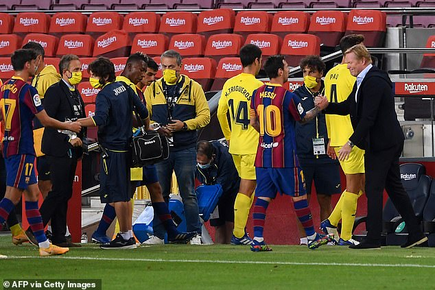 Koeman (right) shakes hands with star man Lionel Messi after the full-time whistle blows