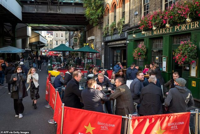 The nation's struggling hospitality sector recorded just 22 outbreaks of respiratory infections - including Covid-19, a drop of 12 from the total identified from September 14 to 20 (Pictured: Pubgoers in London's Borough Market last week)