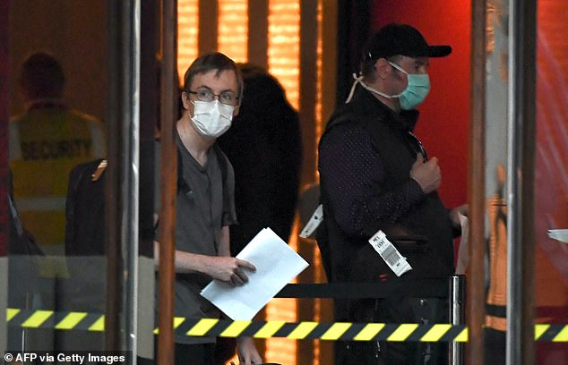 Pictured: A traveller returned from overseas is checked into an inner-city hotel in Melbourne on March 30. Lawyers at the inquiry said the program failed to meet its primary objective