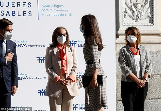 Queen Letizia (pictured second from right) practiced strict social distancing as she spoke to others in attendance includingSpanish Minister of Ecological Transition and Demographic Challenge, Teresa Ribera (pictured right)