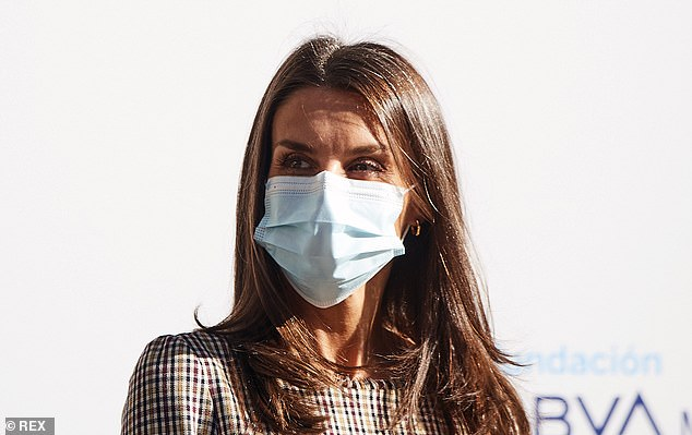 Letizia (pictured) appeared to have opted for minimal makeup underneath her disposable medical face mask