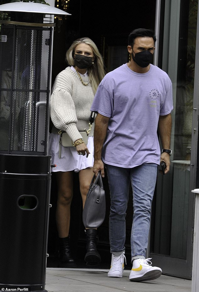 Couple: Gareth paired his laid-back look with high-top Nike white trainers featuring a yellow swoosh as he carried a grey leather bag
