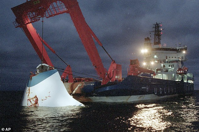 In this November 19, 1994 file photo, the bow door of the sunken passenger ferry MS Estonia is lifted up from the bottom of the sea, off Uto Island, in the Baltic Se