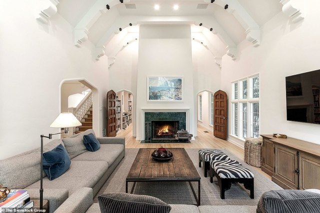 Old world with a modern touch:There are beams on the ceilings that are painted white with black accents as well