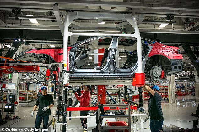 Musk opened his Fremont, California Tesla plant in May in defiance of Alameda County lockdown regulations and sued the county for trying to shutter the plant. A view of workers assembling cars at the plant above in 2015