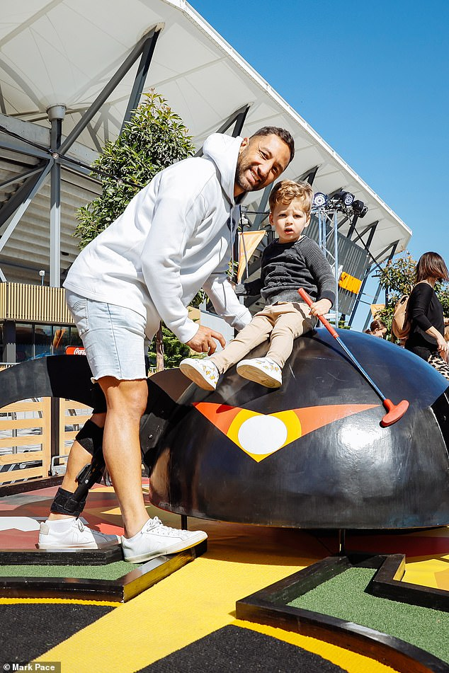 Fun day out: The family were in good spirits as they tested out the Pixar-themed mini-golf course at Bankwest Stadium, in western Sydney