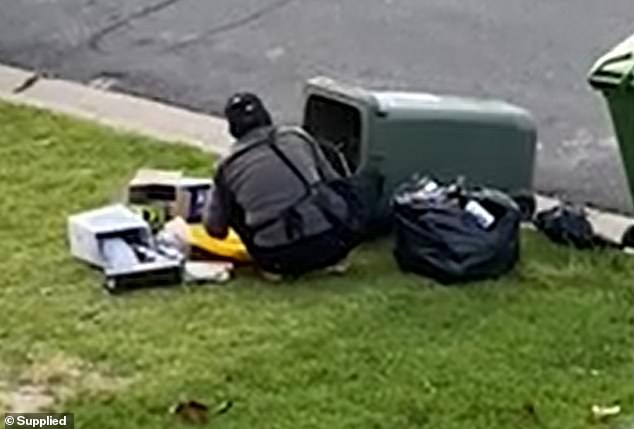 Southport residents say they are fed up with bin divers (pictured) regularly rummaging through their bins