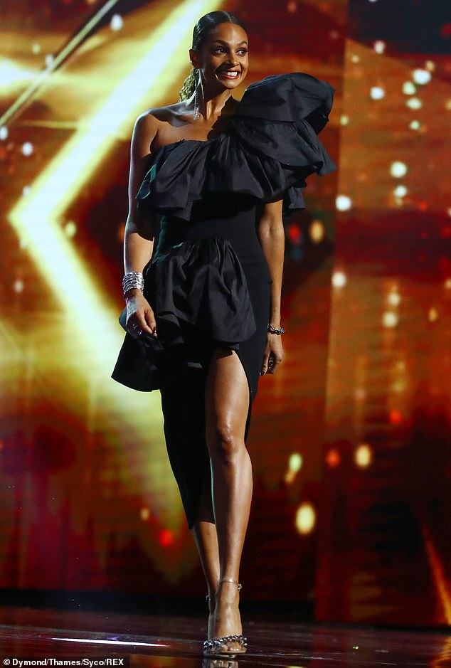 Stunning:Meanwhile, her co-judge Alesha Dixon, 41, looked equally glamorous in a dramatic ruffled black mini dress, with a statement shoulder piece