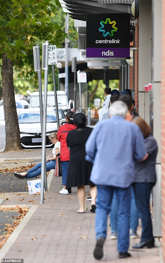 People line up outside the Centrelink office in Norwood, Adelaide. Welfare recipients will soon have to use facial recognition technology to apply for government benefits