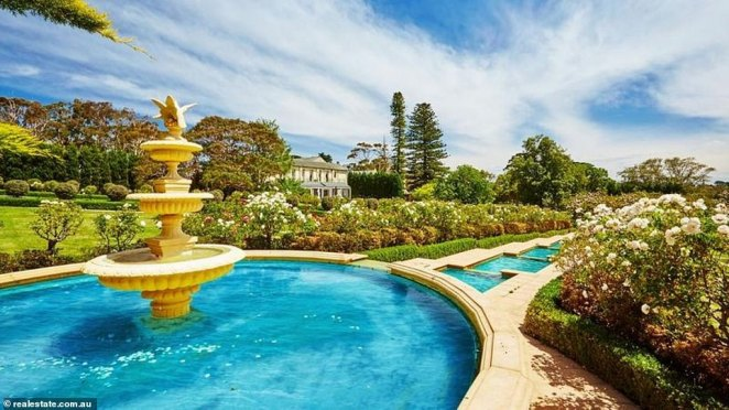 The seaside property, dubbed 'Downtown Abbey of Australia', is about 54 kilometres south of Melbourne and is 63.2 hectares (pictured, the garden's dramatic water feature)