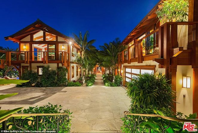 A shot of the courtyard a night makes the home appear more like a resort hotel than a family mansion