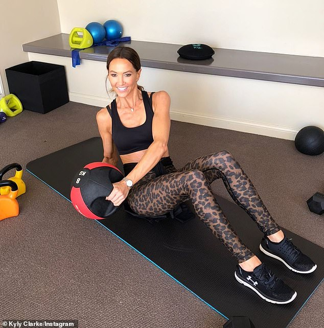 Yummy mummy: On Monday, Kyly Clarke showed off her trim, taut and terrific figure and reminded others about the importance of 'caring for your body'