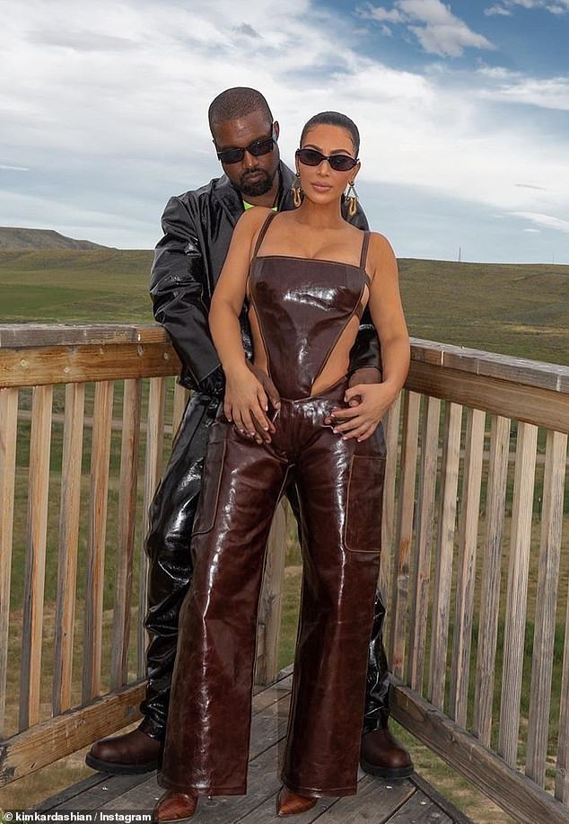 Troubles: Meanwhile, Kim is said to be 'sad' that husband Kanye West (pictured) has been struggling with his mental health and is holding on to her marriage with the rapper