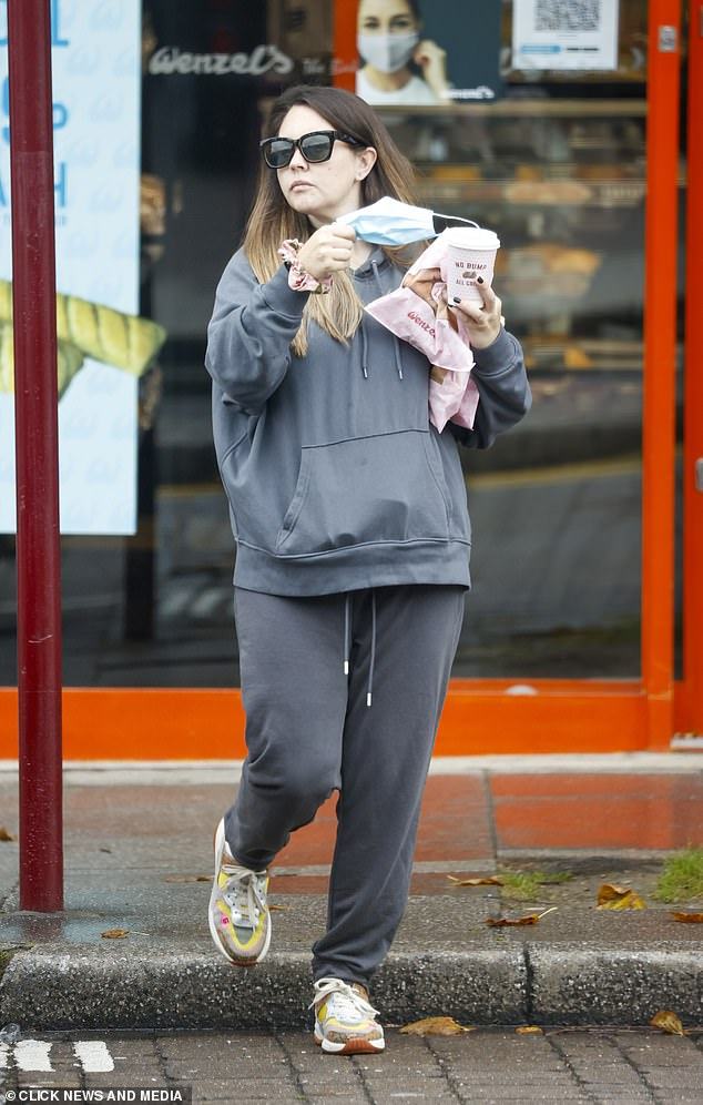 Hot: Lacey kept things casual as she took pregnancy swimming in her loose and comfy two-piece