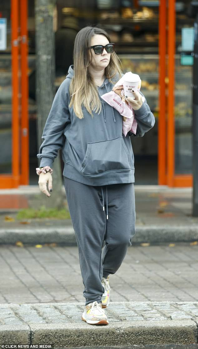 On the go: Seeking pure comfort, Lacey wore an oversized tracksuit with sunglasses and was sure to exercise caution wearing a mask in the bakery