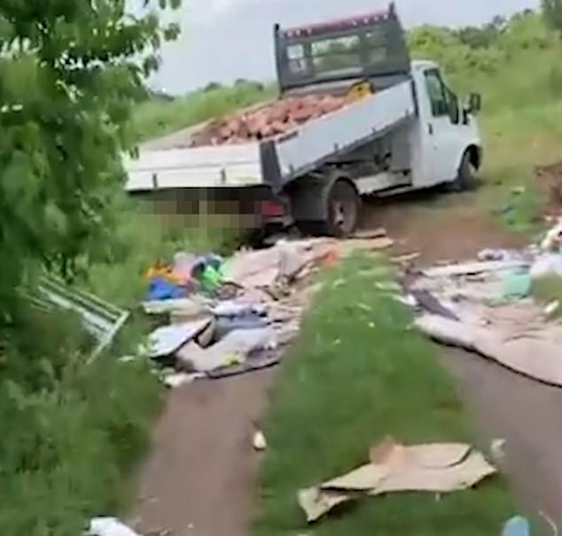 Video footage shows the track covered in rubbish and building rubble, including large pieces of cardboard, next to a white van filled with bricks