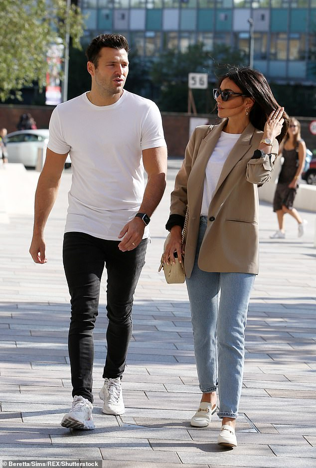 Happy: Mark launched his career as a presenter in the United States playing alongside Mario Lopez on the TV show Extra, but moved home after two years to spend more time with his wife, Michelle