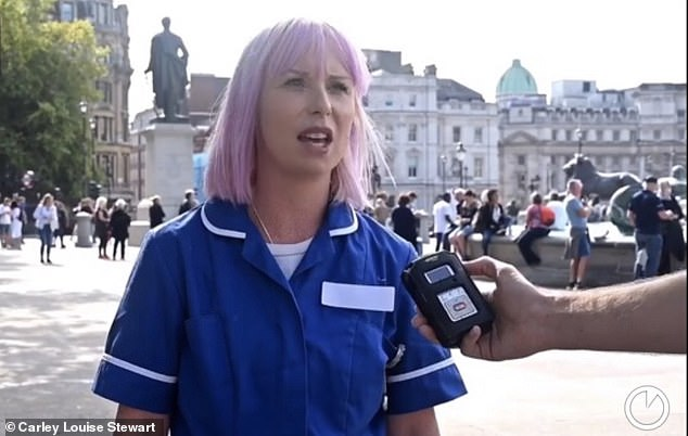 Dressed in her uniform and brandishing a placard with 'We have empty beds' on one side and 'Nurse on call. Where's the pandemic?' on the other at the protest, mother-of-two Carley argued lockdown has done more harm to the British public than coronavirus