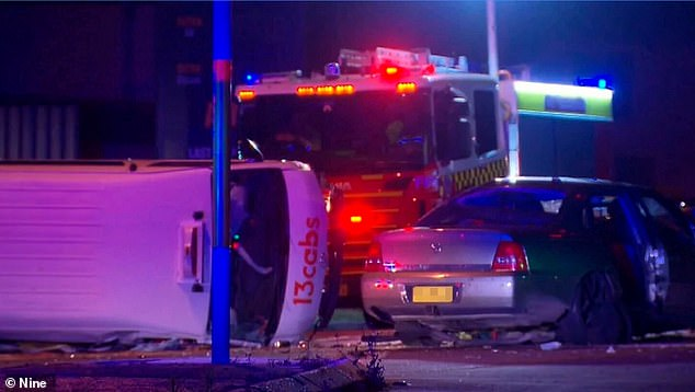 A Holden Statesman, allegedly driven by a 17-year-old boy ran a red light and slammed into the taxi and injured a total of 11 people