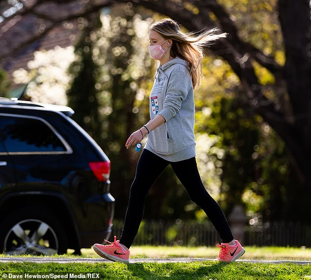 A young woman is pictured exercising in Princes Park on Sunday. A Melbourne GP has called on Premier Daniel Andrews to fully ease the city's strict COVID-19 restrictions to ease the mental health strain on the city's residents