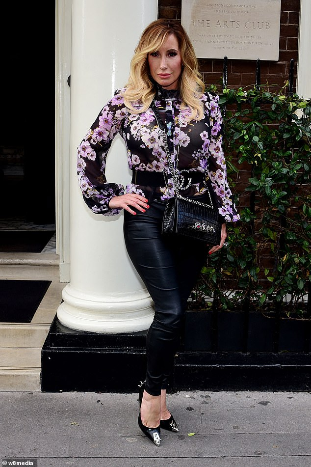 Working it: The mother-of-two rounded things off with a designer waistbelt and a chain-strap handbag