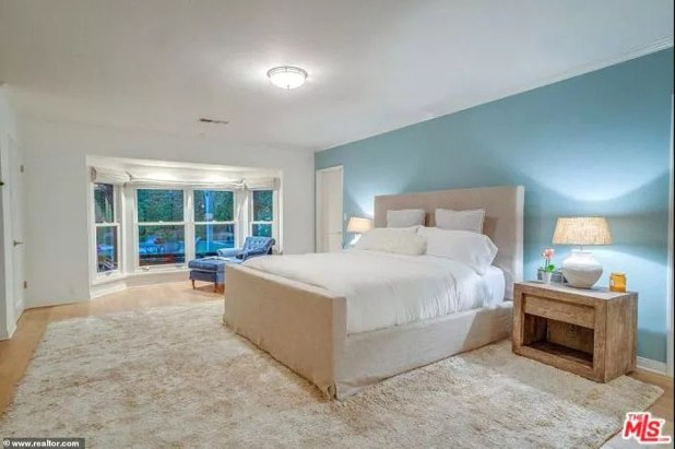 Sleep here: The master bedroom is spacious and even has an reading area with plentiful windows for natural light