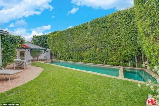A great place to relax: a brick courtyard next to a lush green lawn