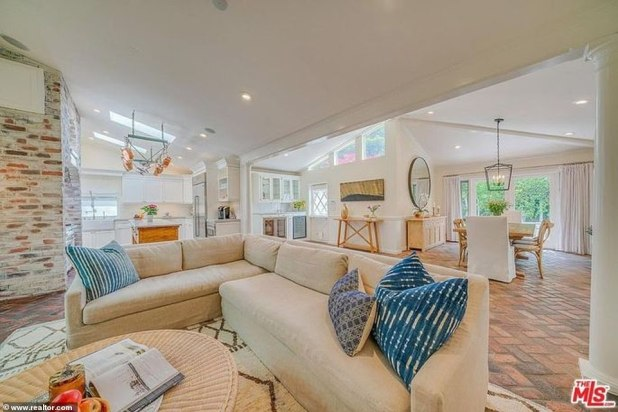 Lounge Zone: High ceilings and recessed lighting inside as well as a ventilated feel on the roof windows.  The floors are made of washed brick, experiencing an old world and have white columns on the side of the entrance to the living room.