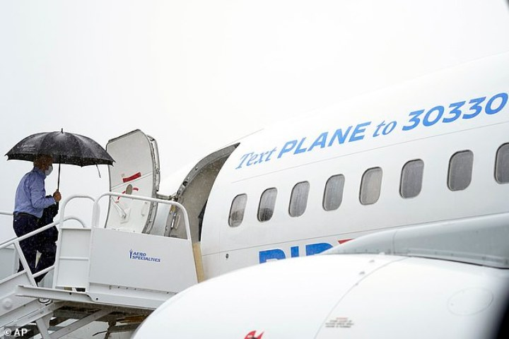 Joe Biden boarded his new campaign plane in the rain for the flight from Wilmington to Ohio