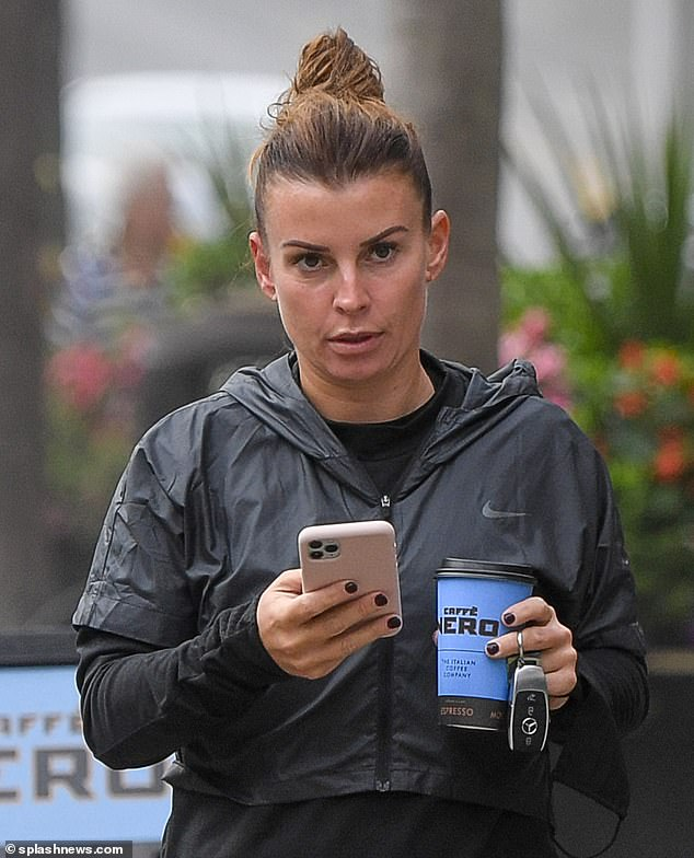 Change of mind? Coleen Rooney (pictured on Tuesday) reportedly wants to make a last-minute exit from her upcoming £1 million libel battle against Rebekah Vardy