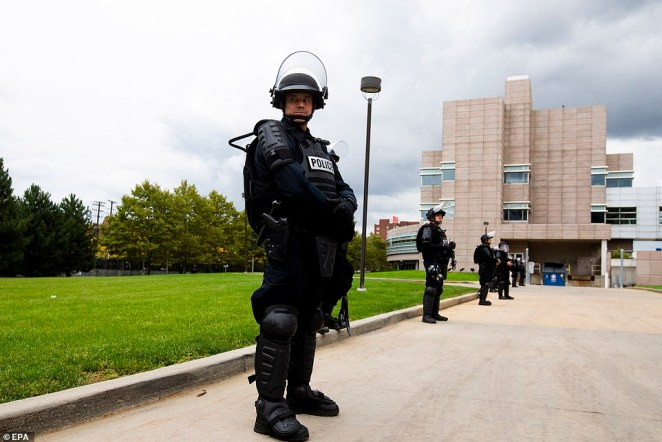 Police line up in front of the debate hall in Cleveland