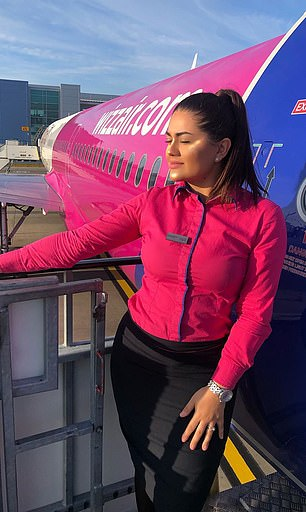 Dobre is pictured on a Wizz Air aircraft