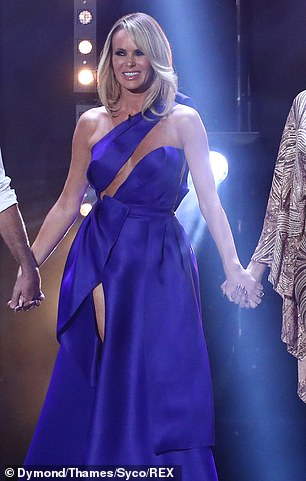 Stunning: She risked a wardrobe malfunction in a striking cut-out number for the second live show